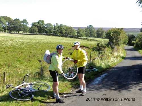 Ken and Rob repairing a puncture near Rookhope